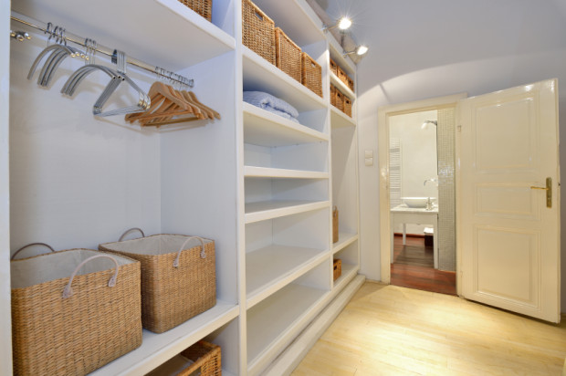 Minimizing closet contents helps when selling your home.