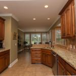 Kitchen with adjacent breakfast area.