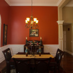 Formal Dining Room with tray ceiling and wainscoting