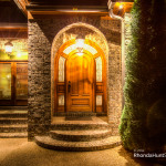 Front door of luxury Waterfront property at night