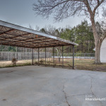 Large covered carport in back
