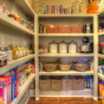 Walk-in pantry with plenty of storage.