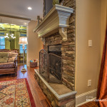 Stone wall gas fireplace.