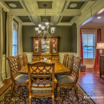 Dining room feature coffered ceiling.