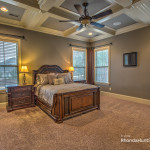 Extra large master bedroom features coffered ceiling.